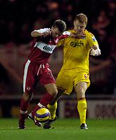 Photo: Jed Wee.<br />Middlesbrough v Liverpool. The Barclays Premiership. 18/11/2006.<br /><br />Middlesbrough's James Morrison (L) holds off Liverpool's John Arne Riise.