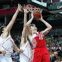 10 August 2012: Russia Andrei Kirilenko goes for the layup past Marc Gasol and Jose Calderon during 67-59 Team Spain victory over Team Russia, during the men's basketball semi-finals, at the North Greenwich Arena, in London, Great Britain.