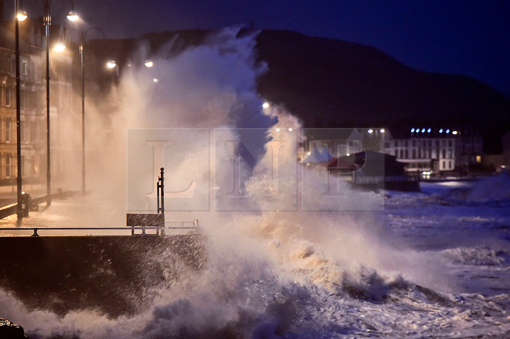 © London News Pictures. 03/01/2018. Aberystwyth, UK.  Storm Eleanor, the fifth named storm of the winter, hits Aberystwyth Wales, with westerly winds gusting up to 80mph bringing huge waves crashing against the sea defences at high tide on Wednesday morning at 7.45am. Photo credit: Keith Morris/LNP