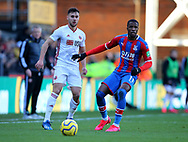 George Baldock of Sheffield Utd and Wilfried Zaha of Crystal Palace during the Premier League match at Selhurst Park, London. Picture date: 1st February 2020. Picture credit should read: Paul Terry/Sportimage