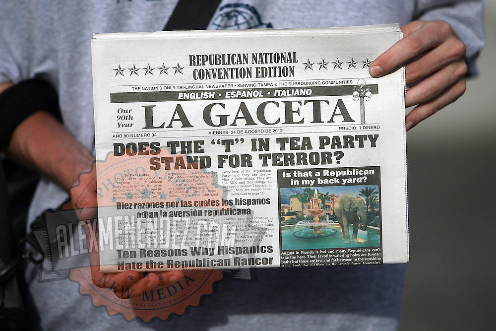 A protester holds a mock newspaper during the Republican National Convention in Tampa, Fla. on Wednesday, August 29, 2012. (AP Photo/Alex Menendez)