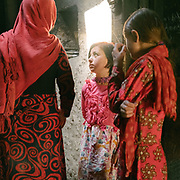 Girls in the kitchen during the festivities around the muslim celebration of Eid-e Qurban (the holiday of Sacrifice). The traditional life of the Wakhi people, in the Wakhan corridor, amongst the Pamir mountains.