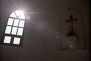 A ray of light goes through a stained glass in Sapa's church, Vietnam, Asia