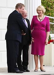 President Michael D Higgins and wife Sabina Coyne say goodbye to outgoing Taoiseach Enda Kenny (left) leaving the Aras an Uachtarain in Dublin, on his last day as Taoiseach.