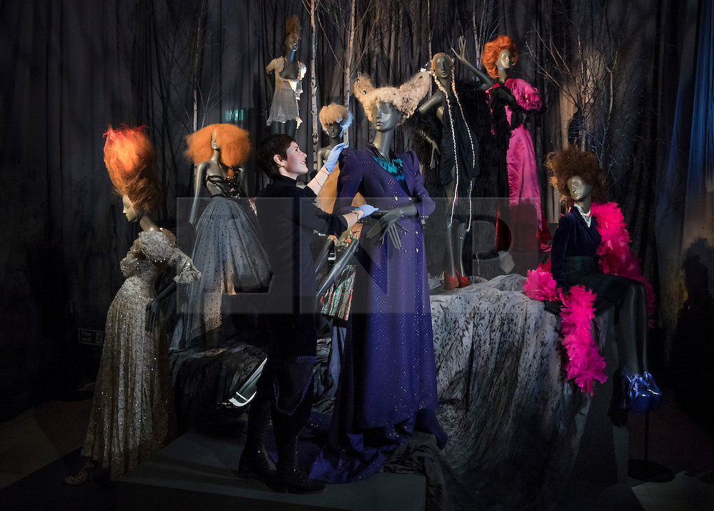 © Licensed to London News Pictures. 01/11/2016. London, UK. Curator Shonagh Marshall puts the finishing touches to a display of mannequins dressed in Vivienne Westwood at the 'Hair by Sam McKnight' exhibition at Somerset House. The show, which runs from 2nd November, 2016 to 12th March, 2017, celebrates the career of fashion's favourite hair stylist. Photo credit: Peter Macdiarmid/LNP