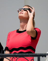 Ivanka Trump looks at the partial eclipse of the sun from the Blue Room Balcony of the White House in Washington, DC on Monday, August 21, 2017.<br /> Credit: Ron Sachs / CNP