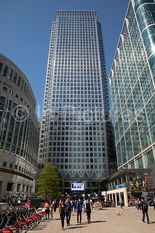 The iconic One Canada Square skyscraper at Canary Wharf financial district in London, England, United Kingdom. 1 Canada Square is the second tallest skyscraper tower in the UK with its distinctive pyramid roof and contains business offices.