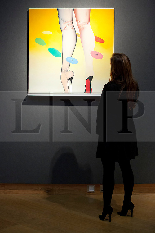 "© Licensed to London News Pictures. 18/11/2013. London, UK. A member of Christie's staff views British artist Allen Jones' 1966/67 oil on canvas ""Gallery Gasper""  (est. GB£200,000 - 300,000) at the press view for a sale of modern British and Irish art at Christie's St James' auction house in London today (18/11/2013). The sale is set to take place on Wednesday the 20th and Thursday the 21st of November 2013. Photo credit: Matt Cetti-Roberts/LNP"