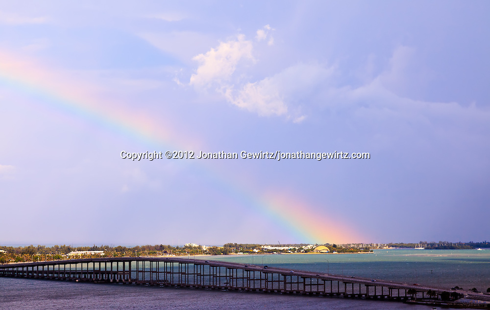 A rainbow appears to originate in the ocean behind Miami Seaquarium, on Virginia Key near Miami, Florida. WATERMARKS WILL NOT APPEAR ON PRINTS OR LICENSED IMAGES.