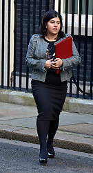 "© under license to London News Pictures. 5th August 2014 Foreign Office minister Baroness Warsi has resigned from the government, saying she can ""no longer support"" its policy on Gaza. FILE PICTURE DATED 18/12/2012. Westminster, UK Baroness Warsi on Downing Street today 18th December 2012. Photo credit : Stephen Simpson/LNP"
