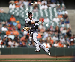 September 20, 2017 - San Francisco, CA, USA - Colorado Rockies shortstop Trevor Story throws to first base to retire the San Francisco Giants' Hunter Pence in the fifth inning at AT&T Park in San Francisco on Wednesday, Sept. 20, 2017. (Credit Image: © Nhat V. Meyer/TNS via ZUMA Wire)