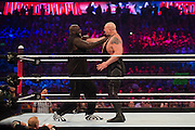 Shaquille O'Neal and The Big Show fight during WrestleMania on April 3, 2016 in Arlington, Texas.