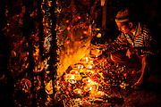 """18th December 2014, New Delhi, India. A man lights an incense stick as an  offering as he asks for wishes to be granted by Djinns in the ruins of Feroz Shah Kotla in New Delhi, India on the 18th December 2014<br /> <br /> PHOTOGRAPH BY AND COPYRIGHT OF SIMON DE TREY-WHITE a photographer in delhi<br /> + 91 98103 99809. Email: simon@simondetreywhite.com<br /> <br /> People have been coming to Firoz Shah Kotla to leave written notes and offerings for Djinns in the hopes of getting wishes granted since the late 1970's. Jinn, jann or djinn are supernatural creatures in Islamic mythology as well as pre-Islamic Arabian mythology. They are mentioned frequently in the Quran  and other Islamic texts and inhabit an unseen world called Djinnestan. In Islamic theology jinn are said to be creatures with free will, made from smokeless fire by Allah as humans were made of clay, among other things. According to the Quran, jinn have free will, and Iblis abused this freedom in front of Allah by refusing to bow to Adam when Allah ordered angels and jinn to do so. For disobeying Allah, Iblis was expelled from Paradise and called """"Shaytan"""" (Satan).They are usually invisible to humans, but humans do appear clearly to jinn, as they can possess them. Like humans, jinn will also be judged on the Day of Judgment and will be sent to Paradise or Hell according to their deeds. Feroz Shah Tughlaq (r. 1351–88), the Sultan of Delhi, established the fortified city of Ferozabad in 1354, as the new capital of the Delhi Sultanate, and included in it the site of the present Feroz Shah Kotla. Kotla literally means fortress or citadel."""