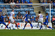Gillingham FC defender Gabriel Zakuani (6) stops the shot from Coventry City midfielder Tony Andreu (22) during the EFL Sky Bet League 1 match between Gillingham and Coventry City at the MEMS Priestfield Stadium, Gillingham, England on 25 August 2018.