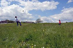 Adoptive father and son playing football; Avebury; Wilts UK
