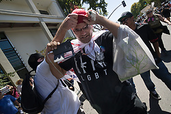 August 27, 2017 - Berkeley, Calif - A Trump supporter is chased from MLK Jr. Civic Center Park by anti-trump-wing activits on Sunday. (Credit Image: © Paul Kuroda via ZUMA Wire)