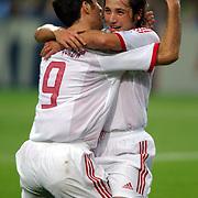 Turkey's Ilhan Mansiz celebrates with Hakan Sukur after scoring Turkey's second goal