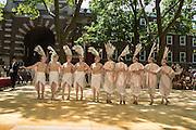 Women dance in the Dreamland Follies, a troupe that harkens to the era of Ziegfeld.