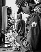The mobile phone was a lifeline between friends and families. MSF built areas for mass mobile charging in the 'La Linière' refugee camp in Grande-Synthe,  Dunkirk, Northern France. April 2016