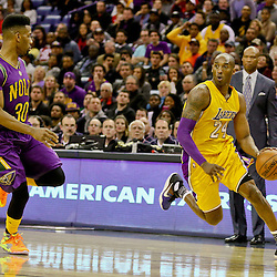 Feb 4, 2016; New Orleans, LA, USA; Los Angeles Lakers forward Kobe Bryant (24) drives past New Orleans Pelicans guard Norris Cole (30) during the second quarter of a game at the Smoothie King Center. Mandatory Credit: Derick E. Hingle-USA TODAY Sports