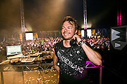 A woman up on shoulders puts her hands in the air during DJ Pete Tong set in the dance tent at the Rockness festival in Scotland in 2008.