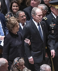 Former United States President George W. Bush and former first lady Laura Bush arrive for the National funeral service in honor of the late former US President George H.W. Bush at the Washington National Cathedral in Washington, DC on Wednesday, December 5, 2018.<br /> Photo by Ron Sachs / CNP/ABACAPRESS.COM