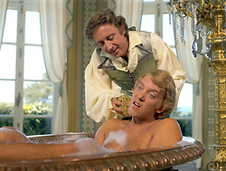 GENE WILDER, (born Jerome Silberman, June 11, 1933 - August 28, 2016) was an American stage and screen comic actor, screenwriter, film director, and author. He was known best for the lead role in the 1971 film 'Willy Wonka in Willy Wonka & the Chocolate Factory,' and the Mel Brooks comedies 'Blazing Saddles', and 'Young Frankenstein', which Wilder co-wrote, garnering the pair an Academy Award nomination for Best Adapted Screenplay. Wilder died at age 83 from complications from Alzheimer's disease. PICTURED: GENE WILDER and DONALD SUTHERLAND in a scene from the 1970 film 'Start the Revolution Without Me.' (Credit Image: © Entertainment Pictures/Entertainment Pictures/ZUMAPRESS.com)