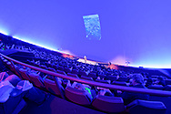 Garden City, New York, USA. June 21, 2018. Space Shuttle Astronaut Mike Massimino, a Long Island native, gives free lecture in JetBlue Sky Theater Planetarium at the Cradle of Aviation Museum. His Lecture was part of the museum's Countdown to Apollo at 50, celebrating 50th anniversary of Apollo 11 moon landing on July 20, 1969.