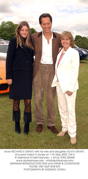 Actor RICHARD E GRANT with his wife and daughter OLIVIA GRANT , at a polo match in Surrey on 11th May 2003.PJK 5