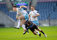 Rugby Union - 2020 / 2021 Guinness Pro-14 - Edinburgh vs Glasgow Warriors - Murrayfield<br /> <br /> Huw Jones of Glasgow Warriors is tackled by Mark Bennett of Edinburgh Rugby<br /> <br /> COLORSPORT/BRUCE WHITE