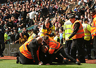 an Aston Villa fan tries to invade the pitch after after Gabriel Agbonlahor of Aston Villa scores a goal and makes it 1-0.  EFL Skybet championship match, Aston Villa v Birmingham city at Villa Park in Birmingham, The Midlands on Sunday 23rd April 2017.<br /> pic by Bradley Collyer, Andrew Orchard sports photography.