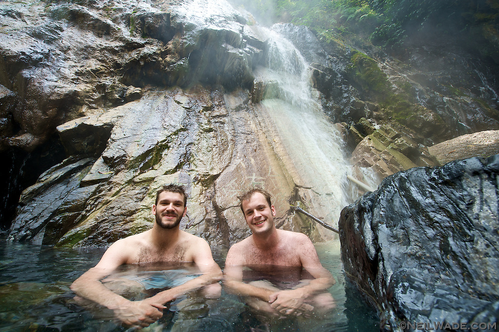 Crystal clear water under a hot spring waterfall...  What could be better?