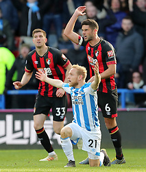 Huddersfield Town's Alex Pritchard appeals to the referee during the Premier League match at the John Smith's Stadium, Huddersfield.