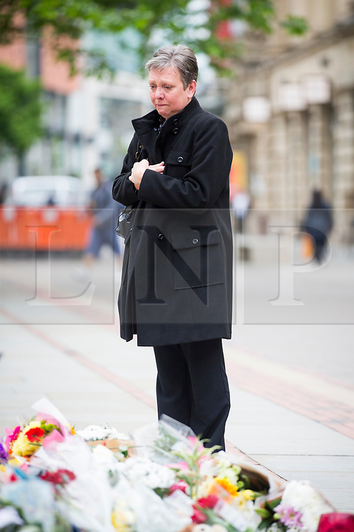 © Licensed to London News Pictures. 24/05/2017. Manchester, UK. Picture shows flowers left at Saint Ann's Square in Manchester this morning in memory of the victims of the Manchester bomb. Greater Manchester Police have named Salman Abedi as the bomber. Photo credit: London News Pictures