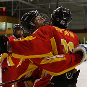 Zhang Cheng, China, (left) is congratulated after scoring by team mate Tiannan Wang during the China V New Zealand match during the 2012 IIHF Ice Hockey World Championships Division 3 held at Dunedin Ice Stadium. Dunedin, Otago, New Zealand. 21st January 2012. Photo Tim Clayton