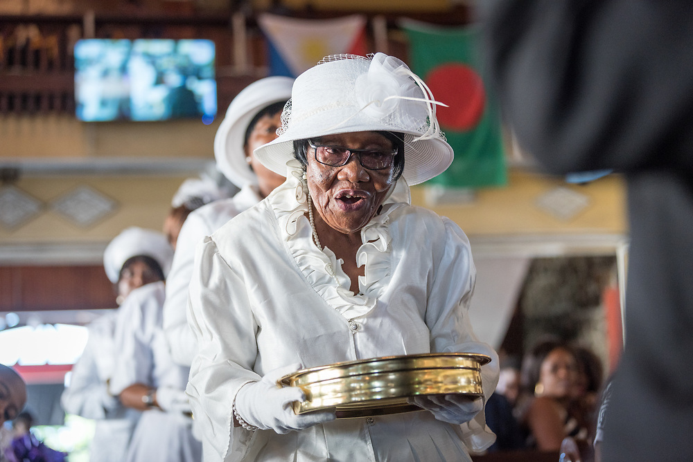 3 November 2019, Monrovia, Liberia: 80-year-old Tarina Grimes Kpardeh returns to the altar after distributing bread and wine during Sunday service at the Providence Baptist Church, also known as 'the cornerstone of the nation', as it was in the Providence Baptist Church that Liberia's declaration of independence was signed. While this Sunday service is taking place in a larger worship space finalized in 1976, the old chapel remains in place adjacent to the new one, and is still in use.