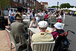Racegoers enjoy refreshments at Haydock Park Racecourse.