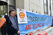 A climate change protester at Shell oil HQ on 15th April 2019 in London, United Kingdom.  Extinction Rebellion a climate change protest group are protesting  across the centre of London and plan to block traffic for the next five days.