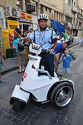 Israel, Haifa, Israeli policeman on a T3 series Electric Stand-up Vehicle (ESV)