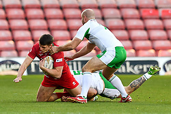 11th November 2018 , Racecourse Ground,  Wrexham, Wales ;  Rugby League World Cup Qualifier,Wales v Ireland ; Rhodri Lloyd of Wales is tackled by Ethan Ryan of Ireland <br /> <br /> <br /> Credit:   Craig Thomas/Replay Images