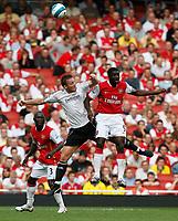 Photo: Steve Bond.<br />Arsenal v Derby County. The FA Barclays Premiership. 22/09/2007. Steve Howard (L) and Kolo Toure (R) challange for an aeriel ball