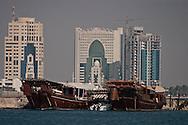 = traditional boats in Doha port and new sky scrappers building in west bay  Doha  QATAR ///   bateaux traditionnels dans le port de Doha et nouveaux gratte- ciel  Doha  QATAR +