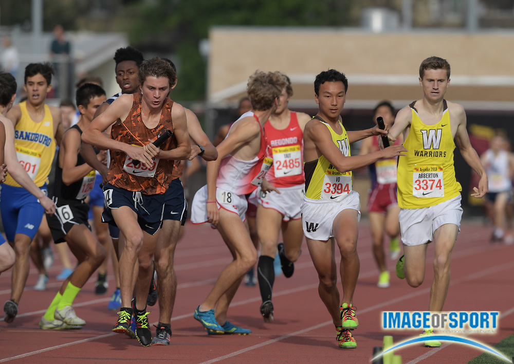 Ryan Vo (3394) of West Torrance takes handoff from Rory Abberton (3374) in the seeded 4 x 800m relay during the 51st Arcadia Invitational in Arcadia, Calif., Friday, April 6, 2018.
