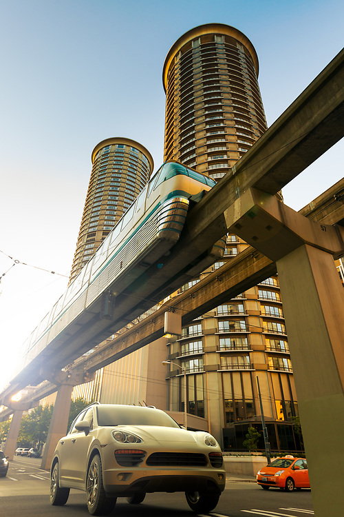 3D rendering of a SUV on motion under the Seattle monorail.