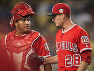 Angels' starter Andrew Heaney talks with catcher Carlos Perez after getting out of a jam during the Angels' Freeway Series game against the Dodgers Thursday night at Dodger Stadium.<br /> <br /> ///ADDITIONAL INFO:   <br /> <br /> freeway.0401.kjs  ---  Photo by KEVIN SULLIVAN / Orange County Register  --  3/31/16<br /> <br /> The Los Angeles Angels take on the Los Angeles Dodgers at Dodger Stadium during the Freeway Series Thursday.<br /> <br /> <br />  3/31/16