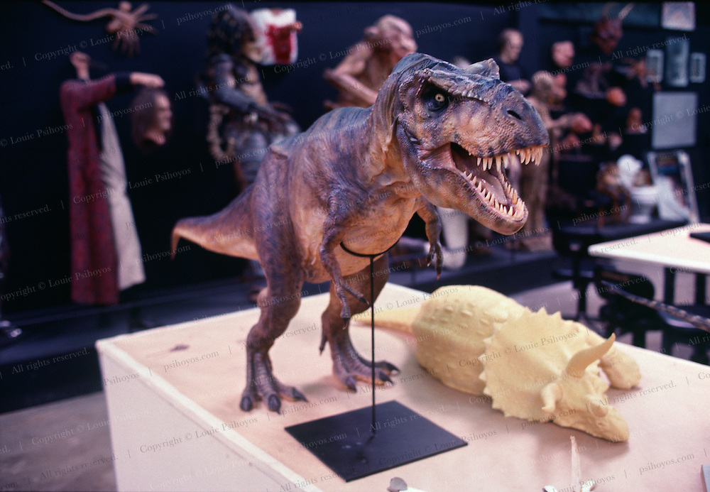 """At Stan Winston Studios outside L.A. in Van Nuys, CA., the dinosaurs, like this T.Rex for Steven Spielberg's action epic, Jurassic Park were created.  Stan is one of Hollywoods most innovative character creators.<br /> <br /> Famous Jurassic Park Ride at Universal Studio's Amusement Park in Southern California.  Jurassic Park was one of the largest grossing movies ever made, directed by Steven Spielberg.<br /> <br /> <br /> T. Rex, """"tyrant lizard king,"""" was one of the largest-ever meat eating land animals.  The bi-pedal giant grew to some 40 feet (12 meters) and weighed up to 7 US tons (6.5 metric tons) and small two-fingered hands that were actually surprisingly strong."""
