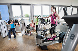 Four woman fitness studio modern sport