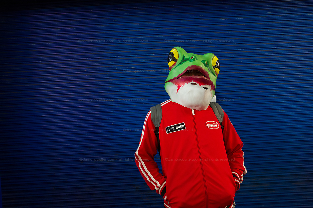 A man in a frog mask costume during the Halloween celebrations Shibuya, Tokyo, Japan. Saturday October 27th 2018. The celebrations marking this event have grown in popularity in Japan recently. Enjoyed mostly by young adults who like to dress up, drink , dance and misbehave in parts of Tokyo like Shibuya and Roppongi. There has been a push back from Japanese society and the police to try to limit the bad behaviour.