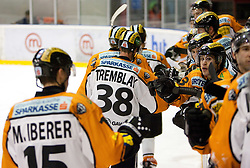 Players of Graz celebrate after 3rd goal during ice hockey match between HK Acroni Jesenice and  Moser Medical Graz 99ers in 24th Round of EBEL league, on December 3, 2010 in Arena Podmezakla, Jesenice, Slovenia.  (Photo By Vid Ponikvar / Sportida.com)