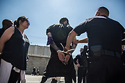 One of the participants get arrested during immigration rally took place in front of Metropolitan Detention Center on Monday, July 2nd, 2018 in Downtown Los Angeles in California.